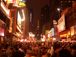 A bunch of Times Square revelers waiting for the ball to drop. Whoopee. Image courtesy of Wikipedia user Chensiyuan via Wikimedia Commons.