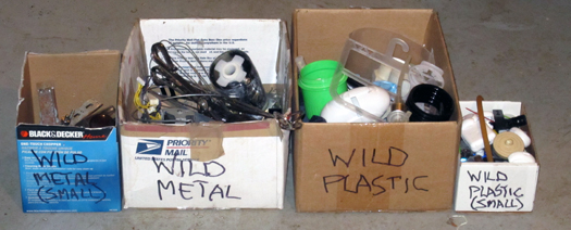 Two-bit Guru - How To Organize Your Clutter - Photo of boxes used to organize junk, metal, plastic, etc.