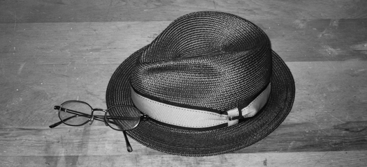 Two-bit Guru - Can Do - Black and white photo of a fedora and wire rimmed glasses