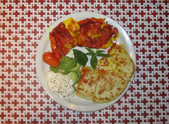 Two-bit Guru | Quick and Easy Breakfast Ideas | Photo showing a breakfast made of eggs, a quesadilla, cottage cheese and ground pepper, a sliced avocado, a miniature paste tomato, basil and salsa