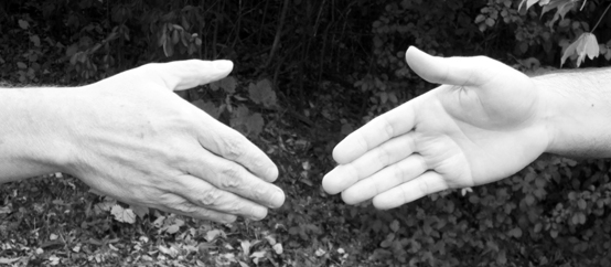 Two-bit Guru | For-Give Ness | Black and white photo of two hands shaking.