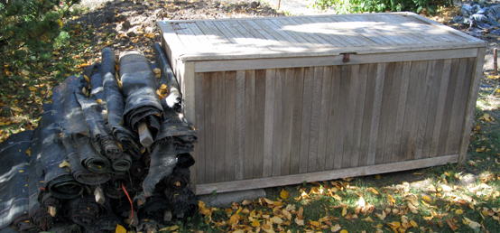 Two-bit Guru   Salvaged Goods   Photo of silt fencing and a wooden box received from a neighbor