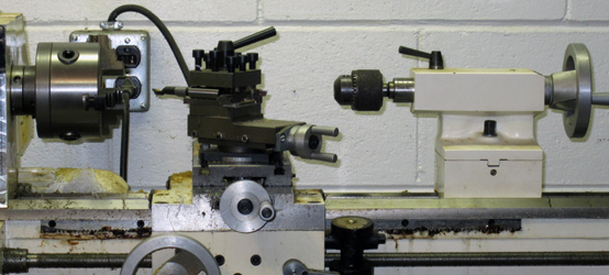 Two-bit Guru | Let it Percolate | Photo of a lathe in a machine shop.