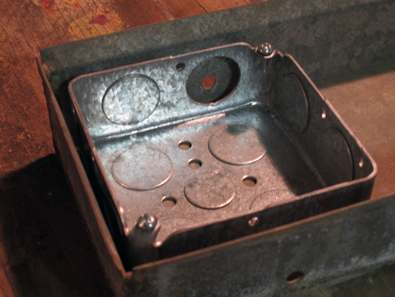 Two-bit Guru | Plant Heaters | Photo of the electrical box inside the galvanized metal tray.