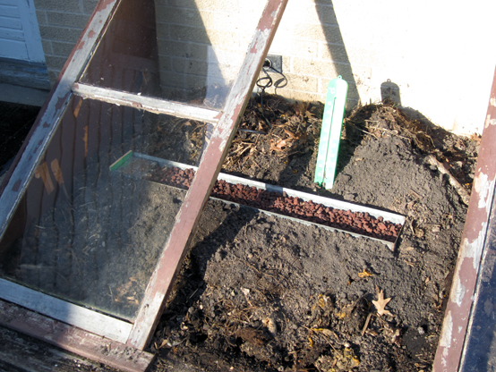 Two-bit Guru | Plant Heaters | Photo of a cold frame with the completed plant heater installed.