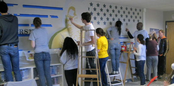 Two-bit Guru | MLK Day Activities | Volunteers painting a mural honoring Martin Luther King, Jr. at Nativity Jesuit Middle School in Milwaukee, WI | Photo courtesy of Barb Grandoe