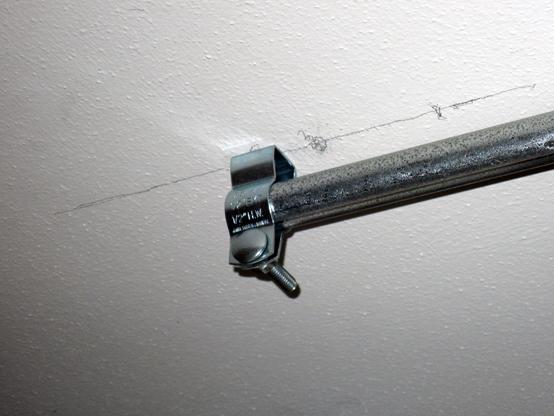 Two-bit Guru | How to Heat a Cold Room | The hanger bracket near the bookshelf.