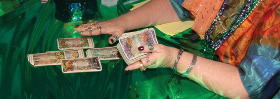 Two-bit Guru | Psychic Experience | Photo of a fortune teller and tarot cards | Image courtesy of Wikipedia Commons.